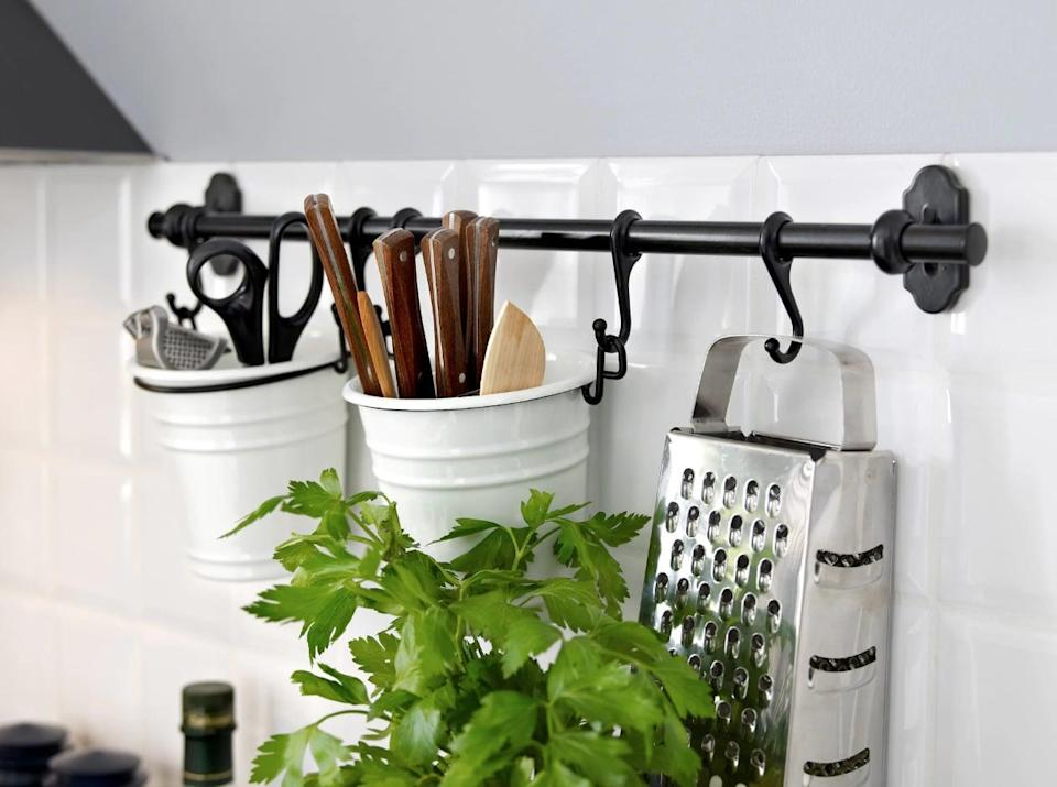 "<p>Hang the <a href=""https://www.popsugar.com/buy/Fintorp%20Utensil%20Holder-446976?p_name=Fintorp%20Utensil%20Holder&retailer=ikea.com&price=7&evar1=casa%3Aus&evar9=46151613&evar98=https%3A%2F%2Fwww.popsugar.com%2Fhome%2Fphoto-gallery%2F46151613%2Fimage%2F46152162%2FFintorp-Utensil-Holder&list1=shopping%2Cikea%2Corganization%2Ckitchens%2Chome%20shopping&prop13=api&pdata=1"" rel=""nofollow noopener"" target=""_blank"" data-ylk=""slk:Fintorp Utensil Holder"" class=""link rapid-noclick-resp"">Fintorp Utensil Holder</a> ($7) on a hook, and keep your must-have cutlery in reach.</p>"