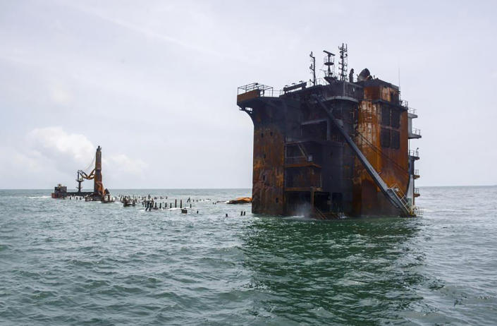 """This photo provided by Sri Lankan Navy shows the sinking MV X-Press Pearl off Colombo port, Sri Lanka, Thursday, June 17, 2021. The container ship carrying chemicals sank off Sri Lanka's capital on Thursday nearly a month after catching fire, raising concerns about a possible environmental disaster. The ship's operator said the wreck of the Singapore-flagged X-Press Pearl """"is now wholly sitting on the seabed at a depth of 21 meters (70 feet)."""" (Sri Lanka Navy via AP)"""