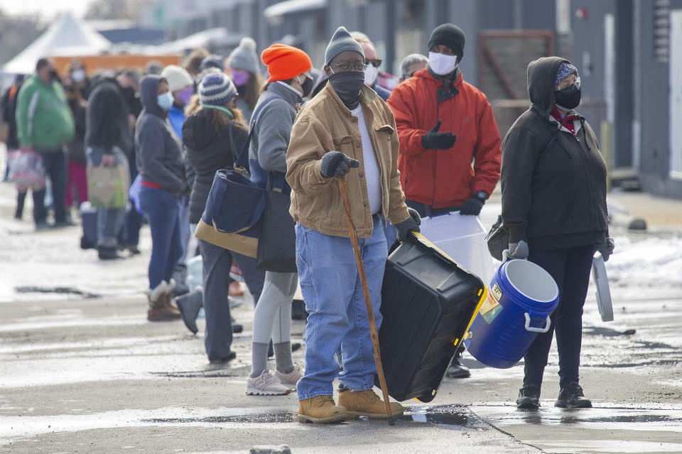 Elmo Houston waiting in line at St. Elmo Brewery for free potable water. Source: AAP