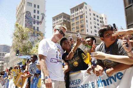 Jun 12, 2018; Oakland, CA, USA; Golden State Warriors head coach Steve Kerr interacts with fans during the Warriors 2018 championship victory parade in downtown Oakland. Mandatory Credit: Cary Edmondson-USA TODAY Sports