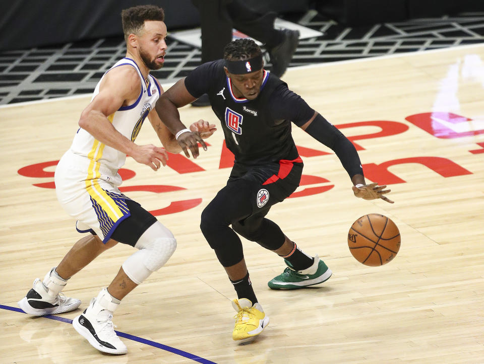 Reggie Jackson tries to control the ball as Stephen Curry puts pressure on him.