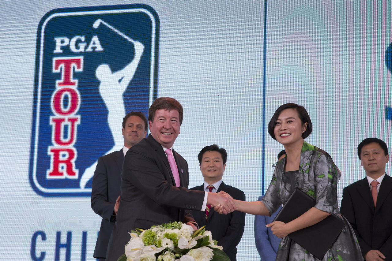Greg Gilligan, PGA Tour's Greater China managing director, second from left, shakes hands with Hong Li, co-founder and Chairwomen of Shankai Sports, during a signing ceremony to announce their joint partnership and management of the PGA Tour China series for 20 years from 2018 at a hotel in Beijing Thursday, Dec. 7, 2017. Shankai, a Beijing-based firm, says its new venture is receiving a 300 million yuan ($45 million) investment from Yao Capital, a private equity firm co-founded by former Houston Rockets player Yao Ming, and U.S.-based IDG Capital. (AP Photo/Ng Han Guan)