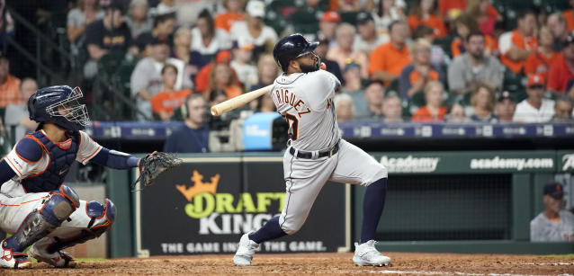 Detroit Tigers' Ronny Rodriguez, right, hits a home run as Houston Astros catcher Robinson Chirinos watches during the sixth inning of a baseball game Monday, Aug. 19, 2019, in Houston. (AP Photo/David J. Phillip)