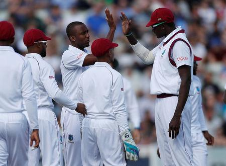 Cricket - England vs West Indies - First Test - Birmingham, Britain - August 17, 2017 West Indies' Jason Holder (R) and Miguel Cummins celebrate the wicket of England's Tom Westley Action Images via Reuters/Paul Childs