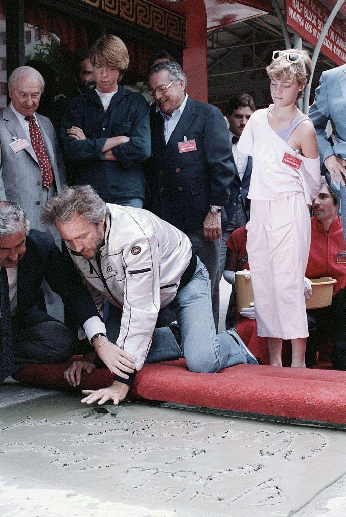 <p>In 1984, the actor received the honor of placing his handprints into the sidewalk at the Grauman's Chinese Theatre. His children, Kyle and Alison, look on. Later that year, Eastwood officially divorced their mother, after being separated for almost 20 years. </p>
