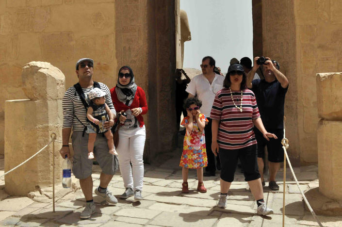 Iranian tourists visit the Hatshepsut Temple, in the ancient southern city of Luxor, Egypt, Tuesday, April 2, 2013. More than 50 Iranian tourists arrived by boat to the ancient city of Luxor on Monday as part of a rare visit that showcases how much ties between the two countries have warmed since Islamist President Mohammed Morsi came to power last year. Diplomatic relations were frozen for decades after Egypt signed the 1979 peace treaty with Israel and Iran went through the Islamic Revolution. But Morsi has been reaching out to Tehran since he came to power in June 2012. (AP Photo/Ibrahim Zayed)
