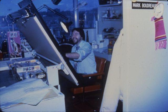 "Boudreaux ""on the boards"" in his Kenner office in the mid-'80s. (Credit: Mark Boudreaux/Hasbro)"