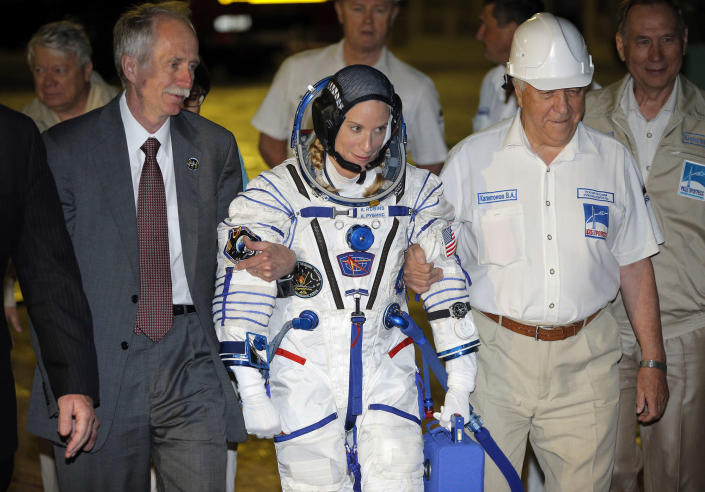 <p>U.S. astronaut Kate Rubins, member of the main crew of the mission to the International Space Station (ISS), walks to the rocket prior the launch at the Russian leased Baikonur cosmodrome, Kazakhstan, Thursday, July 7, 2016. (AP Photo/Dmitri Lovetsky, Pool) </p>