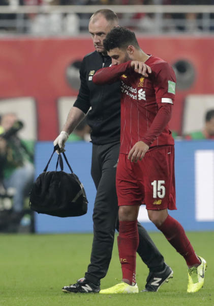 Liverpool's Alex Oxlade-Chamberlain walks off the pitch after suffering an injury during the Club World Cup final soccer match between Liverpool and Flamengo at Khalifa International Stadium in Doha, Qatar, Saturday, Dec. 21, 2019. (AP Photo/Hassan Ammar)