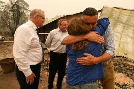 Australia's Prime Minister Scott Morrison (L) has vowed every resource will be provided to help ease the bushfire disaster