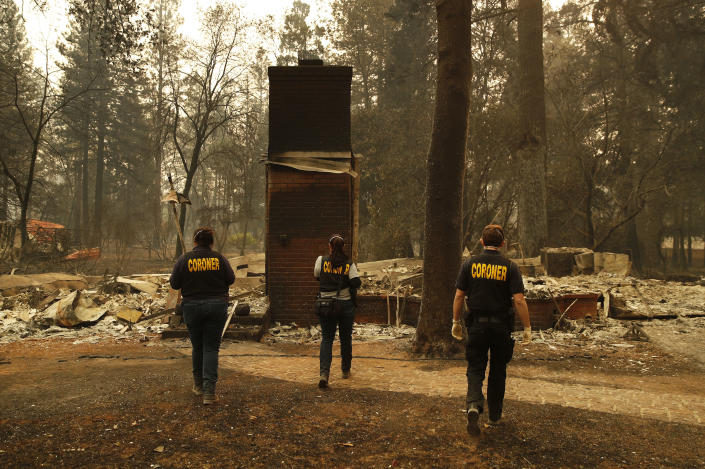 <p>Members of the Sacramento County Coroner's office look for human remains in the rubble of a house burned at the Camp Fire on Monday in Paradise, Calif. (Photo: John Locher/AP) </p>