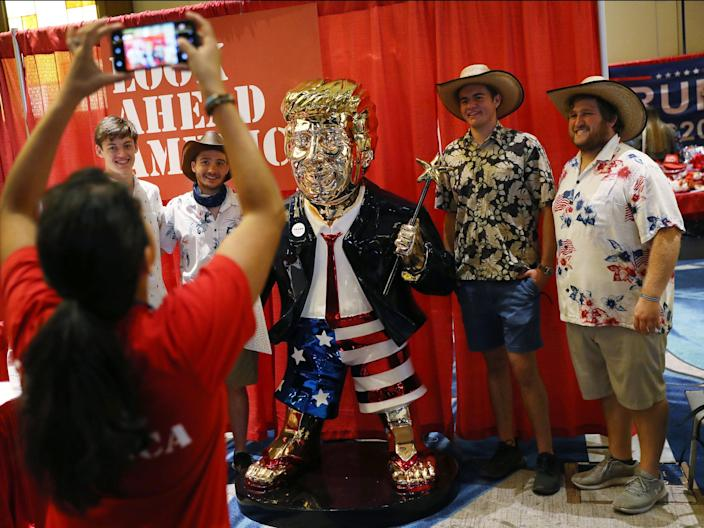 People take a picture with former President Donald Trump's statue on display at CPAC on February 27, 2021 in Orlando, Florida.  (Getty Images)