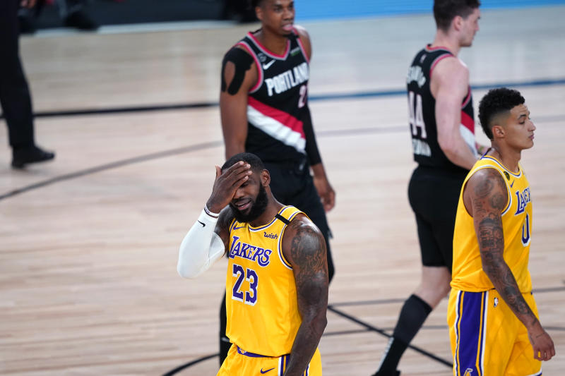 LeBron James reacts during the Lakers' Game 1 loss to the Blazers. (Ashley Landis-Pool/Getty Images)