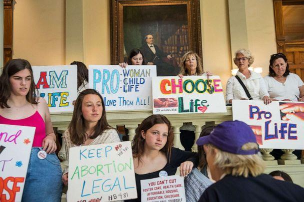 PHOTO: Abortion rights supporters and anti-abortion demonstrators display their signs in the lobby of the Georgia State Capitol building at the Georgia State Capitol building in Atlanta, March 22, 2019. (Alyssa Pointer/Atlanta Journal-Constitution via AP, FILE)