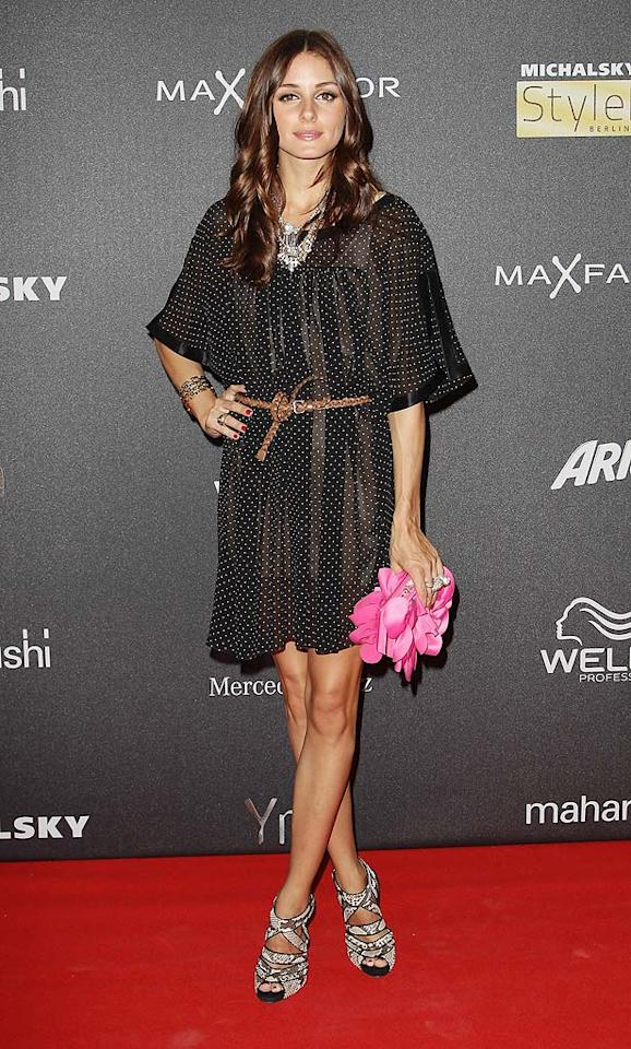 """Also spotted in Berlin during Mercedes-Benz Fashion Week was """"The City's"""" Olivia Palermo, who donned a darker 'do, along with a flirty Michalsky chiffon polka dot dress, Chrissie Morris heels, and a hot pink Sondra Roberts clutch. Andreas Rentz/<a href=""""http://www.gettyimages.com/"""" target=""""new"""">GettyImages.com</a> - July 9, 2010"""