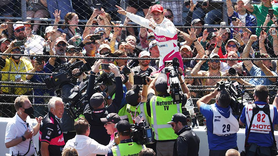 Helio Castroneves, pictured here after winning the Indianapolis 500.