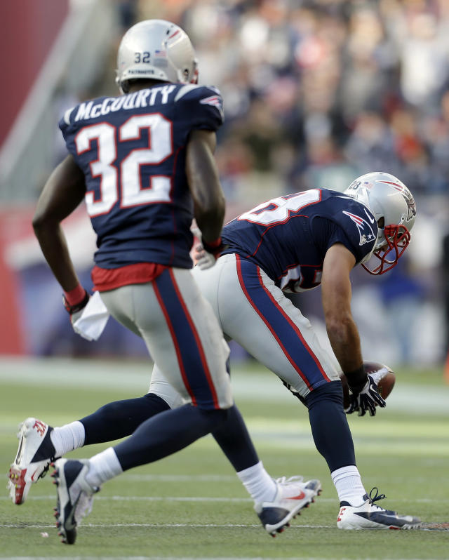 New England Patriots safety Steve Gregory, right, picks up a blocked field goal attempt by the Miami Dolphins in the fourth quarter of an NFL football game Sunday, Oct. 27, 2013, in Foxborough, Mass., as New England Patriots' Devin McCourty (32) runs behind. The Patriots won 27-17. (AP Photo/Steven Senne)