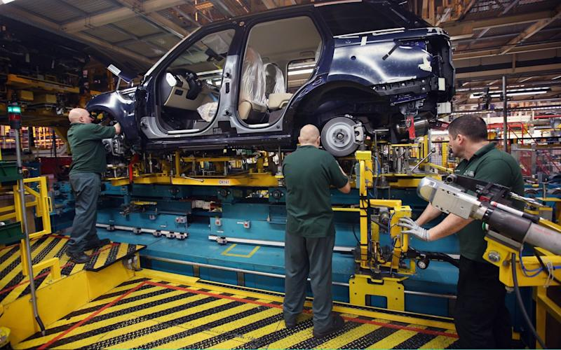 Jaguar Land Rover produces more than 500,000 cars a year at its UK plants - Getty Images