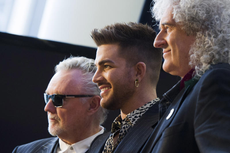 From left, Roger Taylor, Adam Lambert and Brian May announce a Queen + Adam Lambert summer tour, on Thursday, March 6, 2014 in New York. (Photo by Charles Sykes/Invision/AP)