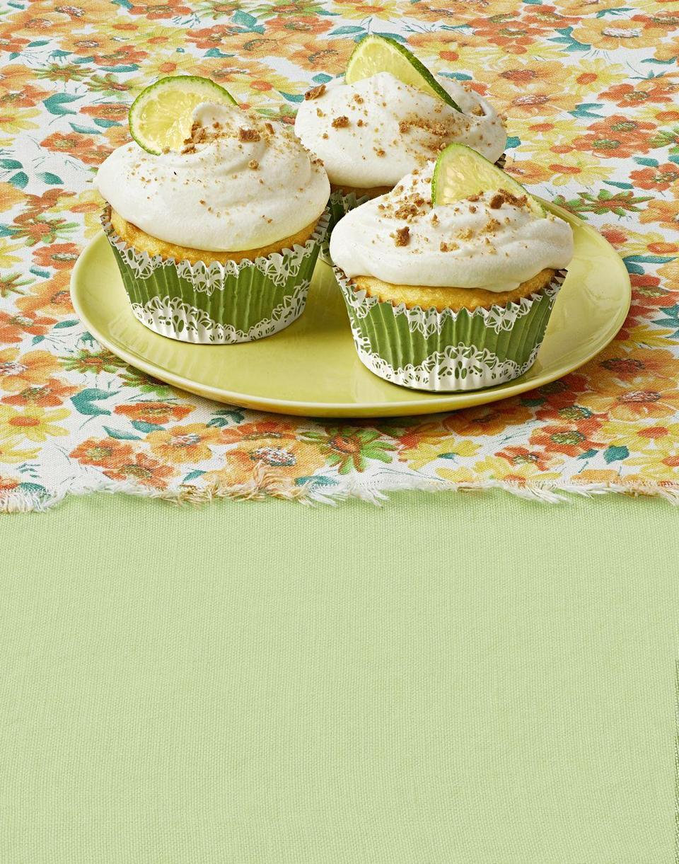 """<p>There's fresh Key lime curd in the middle of each of these cupcakes—as if they're not delicious enough already!</p><p><strong><a href=""""https://www.thepioneerwoman.com/food-cooking/recipes/a32973429/key-lime-pie-cupcakes-recipe/"""" rel=""""nofollow noopener"""" target=""""_blank"""" data-ylk=""""slk:Get the recipe."""" class=""""link rapid-noclick-resp"""">Get the recipe.</a></strong></p><p><strong><a class=""""link rapid-noclick-resp"""" href=""""https://go.redirectingat.com?id=74968X1596630&url=https%3A%2F%2Fwww.walmart.com%2Fip%2FThe-Pioneer-Woman-12-Cup-Non-Stick-Muffin-Pan%2F109556089&sref=https%3A%2F%2Fwww.thepioneerwoman.com%2Ffood-cooking%2Fmeals-menus%2Fg32109085%2Ffourth-of-july-desserts%2F"""" rel=""""nofollow noopener"""" target=""""_blank"""" data-ylk=""""slk:SHOP MUFFIN PANS"""">SHOP MUFFIN PANS</a><br></strong></p>"""