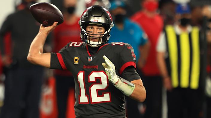 TAMPA, FLORIDA - NOVEMBER 23: Tom Brady #12 of the Tampa Bay Buccaneers looks to pass against the Los Angeles Rams during the second quarter in the game at Raymond James Stadium on November 23, 2020 in Tampa, Florida. (Photo by Mike Ehrmann/Getty Images)