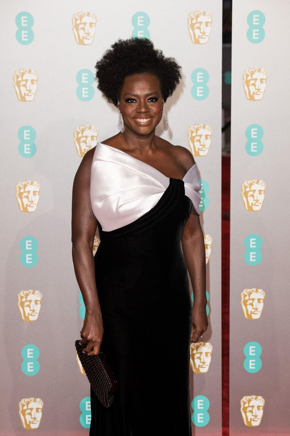 <p>If you want your curls to shine once they're short, ask for layers—and a lot of them. This gives each section its own space, so you have volume instead of short, but heavy hair. The style is seen here on Viola Davis.</p>