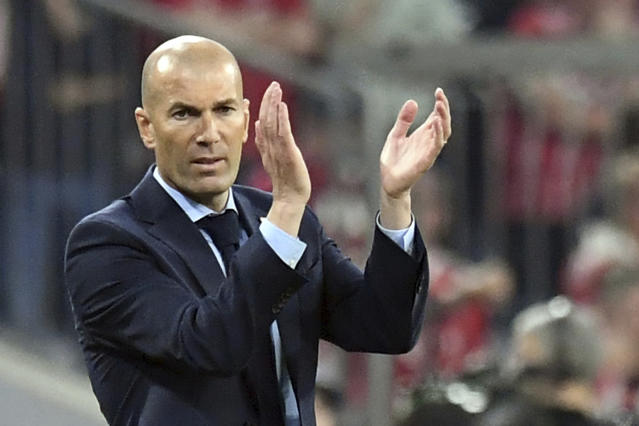 Madrid head coach Zinedine Zidane applauds during the soccer Champions League first leg semifinal soccer match between FC Bayern Munich and Real Madrid in Munich, southern Germany, Wednesday, April 25, 2018. (Matthias Balk/dpa via AP)