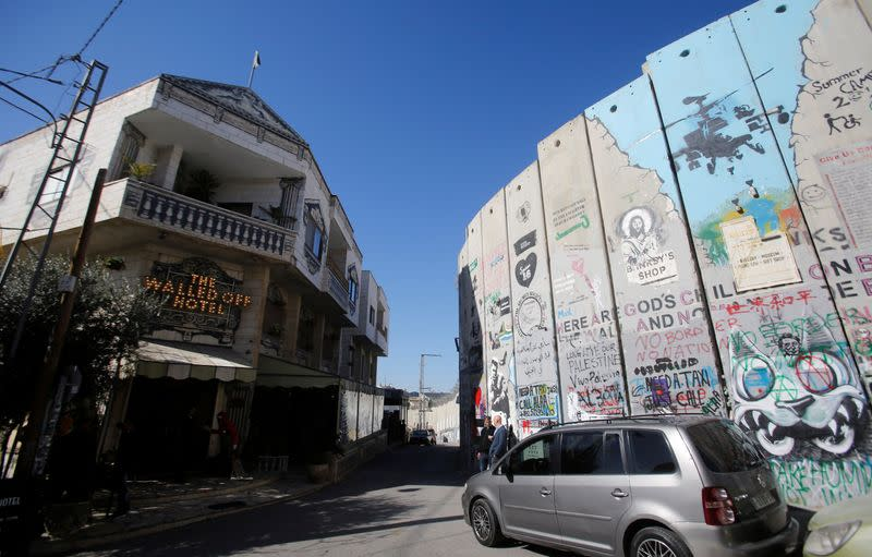 View shows the Walled Off hotel and a section of the Israeli barrier in Bethlehem in the Israeli-occupied West Bank