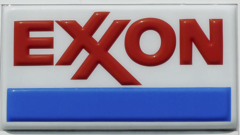 The Exxon corporate logo is pictured at one of the company's gas stations in Arlington, Virginia, August 10, 2011. Apple Inc finished ahead of Exxon Mobil Corp as the largest U.S. company by market capitalization for the first time in history on Wednesday, in the face of a steep drop in U.S. equity markets.  REUTERS/Jason Reed  (UNITED STATES - Tags: BUSINESS ENERGY)