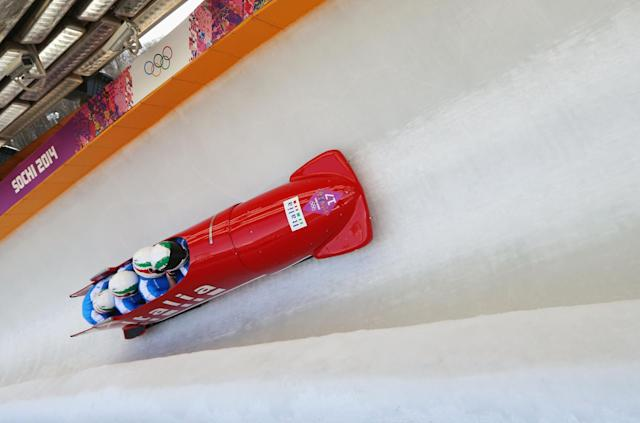 SOCHI, RUSSIA - FEBRUARY 23: Pilot Simone Bertazzo, Simone Fontana, Samuele Romanini and Francesco Costa of Italy team 1 make a run during the Men's Four Man Bobsleigh on day 16 of the Sochi 2014 Winter Olympics at Sliding Center Sanki on February 23, 2014 in Sochi, Russia. (Photo by Mike Ehrmann/Getty Images)
