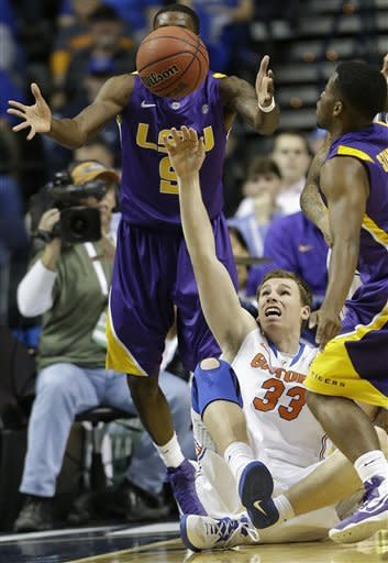 Florida forward/center Erik Murphy (33) vies for a loose ball with LSU guard Andre Stringer, right and LSU forward Johnny O'Bryant III (2) during the first half of an NCAA college basketball game at the Southeastern Conference tournament, Friday, March 15, 2013, in Nashville, Tenn. (AP Photo/John Bazemore)
