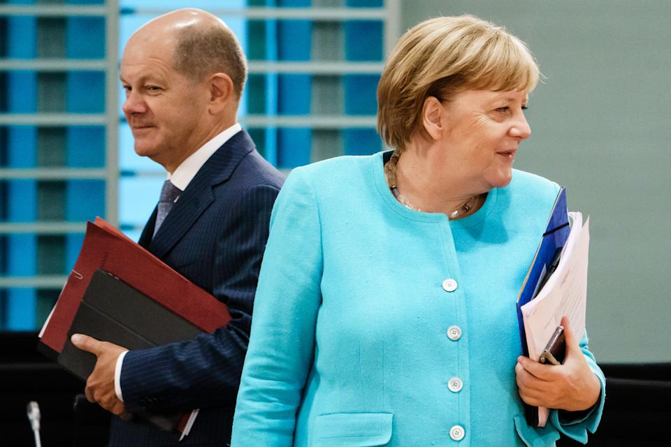 BERLIN, GERMANY - AUGUST 19: German Chancellor Angela Merkel (R) and German Minister of Finance Olaf Scholz attend a cabinet meeting at the German chancellery on August 19, 2020 in Berlin, Germany.  (Photo by Clemens Bilan Pool/Getty Images)