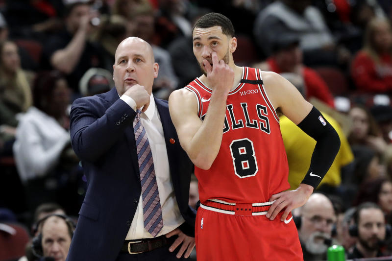 Chicago Bulls coach Jim Boylen talks with guard Zach LaVine during the first half of the team's NBA basketball game against the Charlotte Hornets in Chicago, Thursday, Feb. 20, 2020. (AP Photo/Nam Y. Huh)
