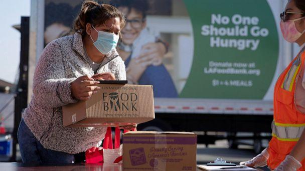 PHOTO:The Los Angeles Regional Food Bank distributes food outside a church in Los Angeles, Nov. 19. 2020. (Mike Blake/Reuters)