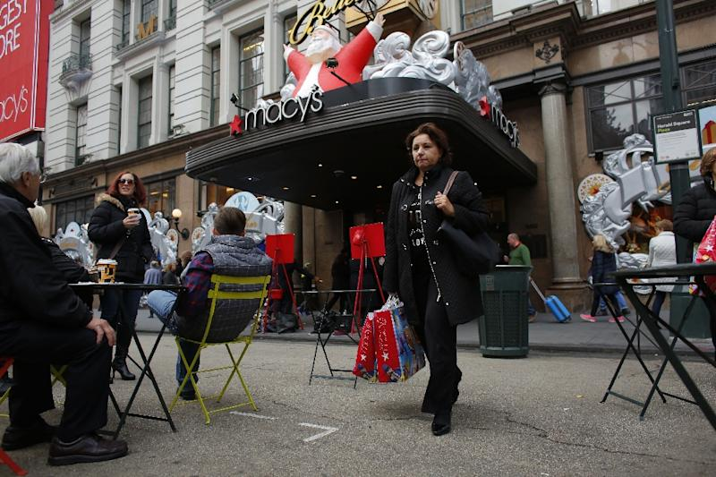 Top retailers have experienced a fall in the number of shoppers passing through their stores, and the tough trading environment has forced Macy's to announced plans to close 100 stores and eliminate some 10,000 jobs (AFP Photo/KENA BETANCUR)