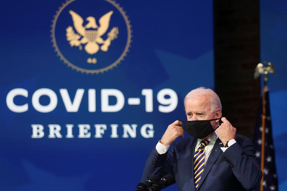 U.S. President-elect Joe Biden takes off his face mask to deliver remarks on the U.S. response to the coronavirus disease (COVID-19) outbreak, at his transition headquarters in Wilmington, Delaware, U.S., December 29, 2020. REUTERS/Jonathan Ernst
