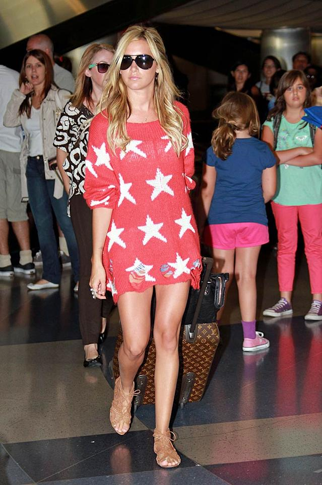 """What do you make of the star-spangled sack Ashley Tisdale rocked, along with a pair of barely-there Daisy Dukes, upon returning to Los Angeles? Andrade/Jones/<a href=""""http://www.pacificcoastnews.com/"""" target=""""new"""">PacificCoastNews.com</a> - August 2, 2011"""