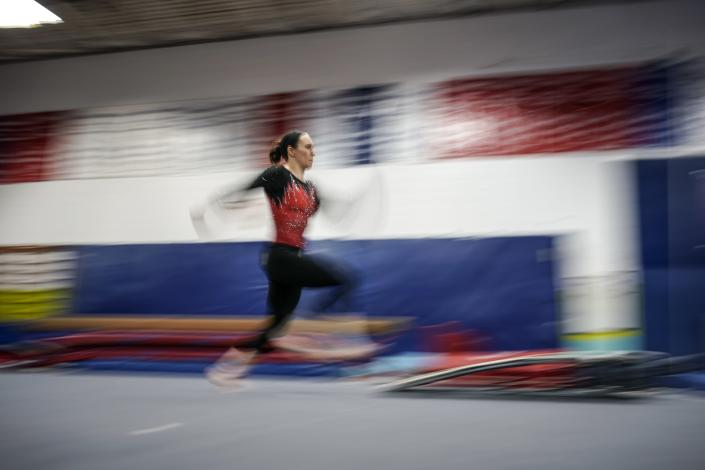 Former world champion and Olympic silver medalist Chellsie Memmel works out Thursday, Feb. 18, 2021, in New Berlin, Wisc. Memmel, 32, is attempting to return to competition following a nearly decade-long break. (AP Photo/Morry Gash)