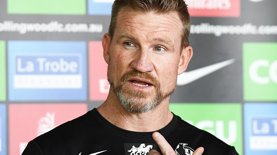 Nathan Buckley talks to the media at Collingwood training. (Photo by Quinn Rooney/Getty Images)