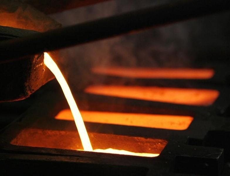 Gold is poured into mould during processing at PT Antam Tbk. precious metal refinery in Jakart