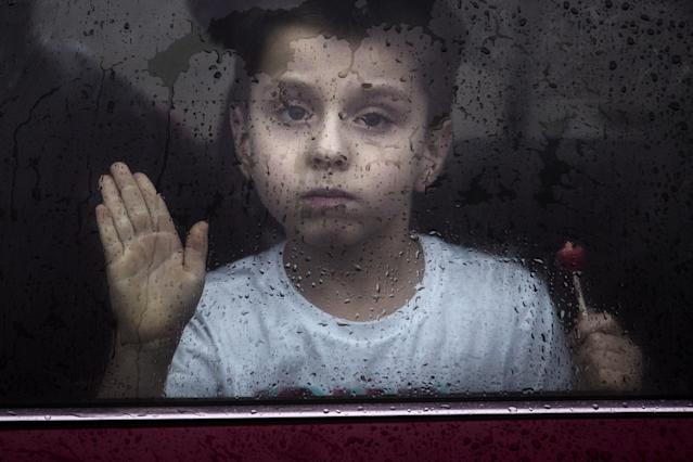 <p>Flint resident Brayden Benado, 5, looks out the window of his parent's car on Robert T. Longway Boulevard Tuesday, Feb. 20, 2018, in Flint, Mich. Earlier Benado was in a vehicle that became stuck when it was driven into high flood waters. (Photo: Bronte Wittpenn/The Flint Journal-MLive.com via AP) </p>