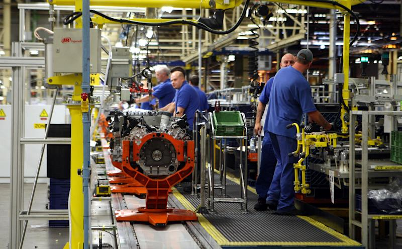 Engineers working on a Jaguar V8 engine at the Ford engine plant near Bridgend, south Wales.