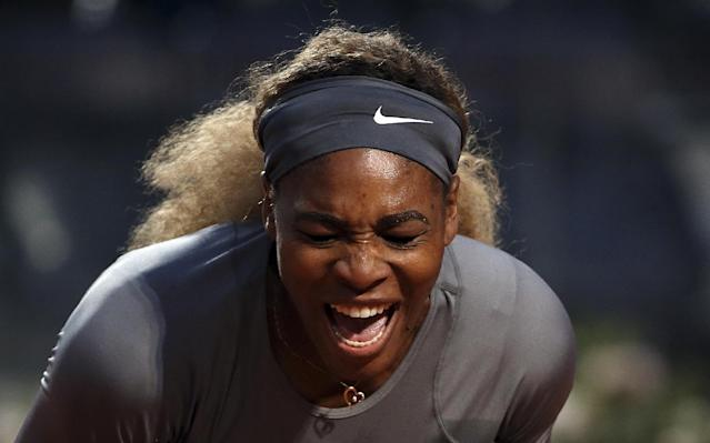 Serena Williams shouts after losing a point during her match against China's Shuai Zhang at the Italian open tennis tournament in Rome, Friday, May 16, 2014. (AP Photo/Gregorio Borgia)