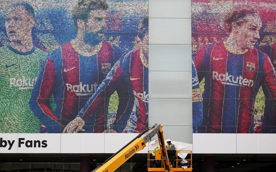 Lionel Messi leaves FC Barcelona - Camp Nou, Barcelona, Spain - August 10, 2021 An image of Lionel Messi is seen being taken down outside the Camp - REUTERS