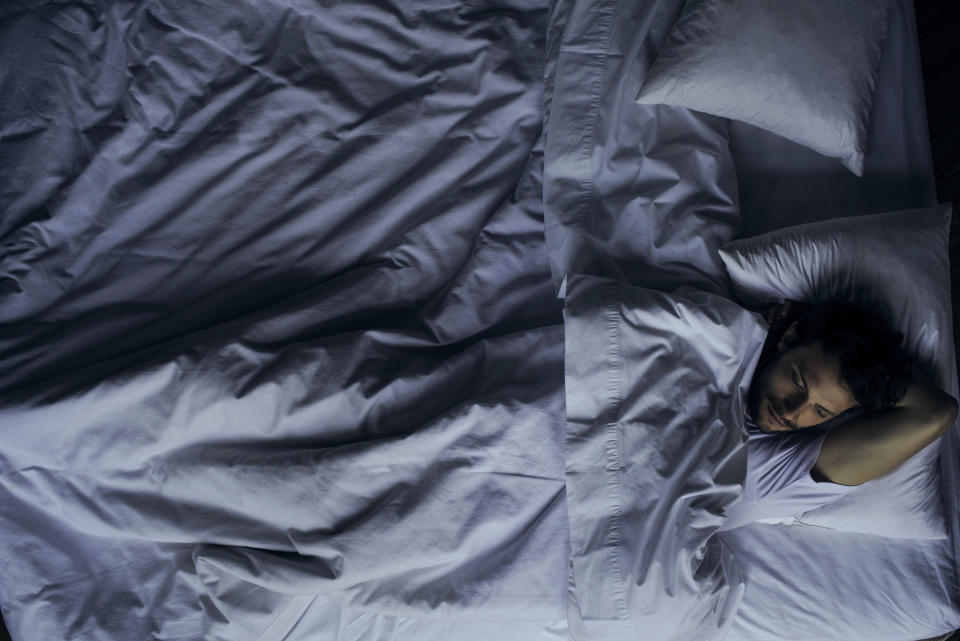 Sleep experts don't recommend lying in bed struggling to sleep for hours on end. (Posed by model, Getty Images)
