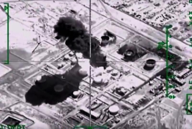 A video image of a Russian air strike on an Islamic State group oil-processing facility at an unidentified location in Syria (AFP Photo/-)