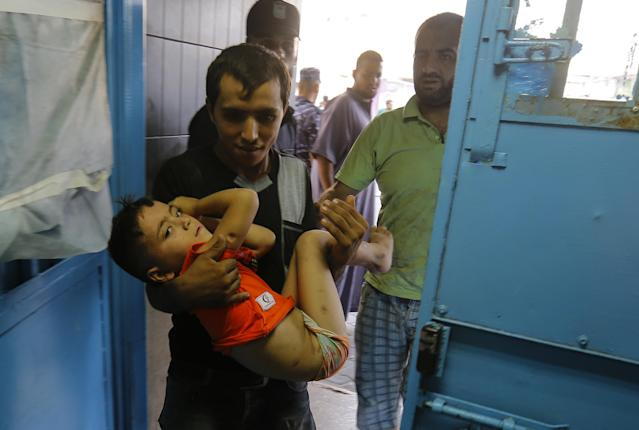 <p>A wounded Palestinian boy is brought into al-Shifa hospital on Aug. 9, 2018, following an Israeli airstrike on Gaza City. (Photo: Anas Baba/AFP/Getty Images) </p>