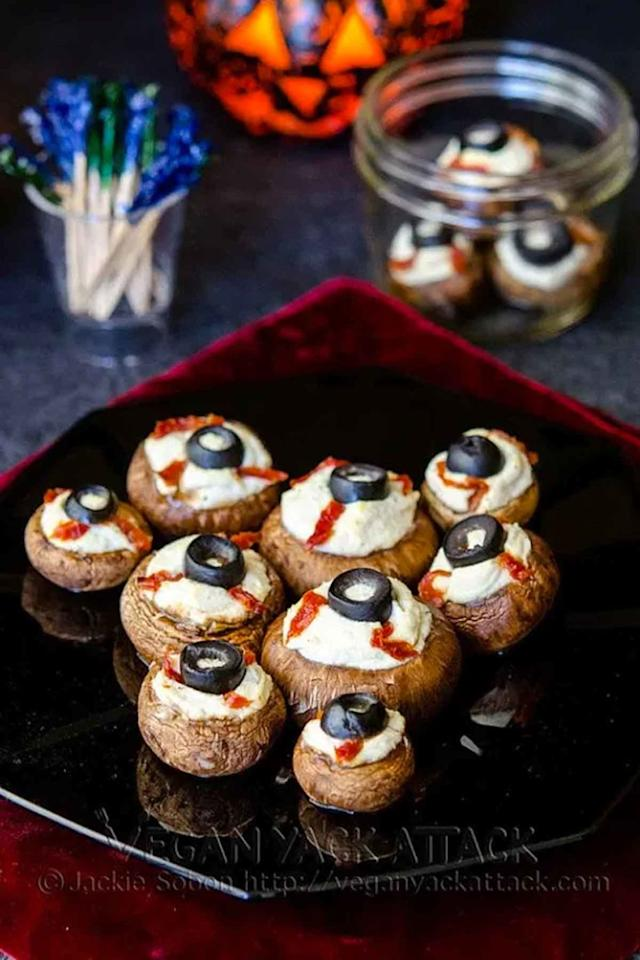 """<p><span>These creepy mushrooms are filled with rich, garlicky flavor and lots of ooey-gooey cheese.</span></p><p><strong>Get the recipe at <a rel=""""nofollow"""" href=""""http://veganyackattack.com/2012/10/26/stuffed-mushroom-eyeballs/"""">Vegan Yack Attack</a>.</strong></p>"""