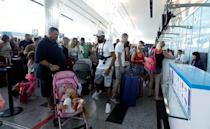 Passengers are seen at check-in points at Enfidha-Hammamet International Airport