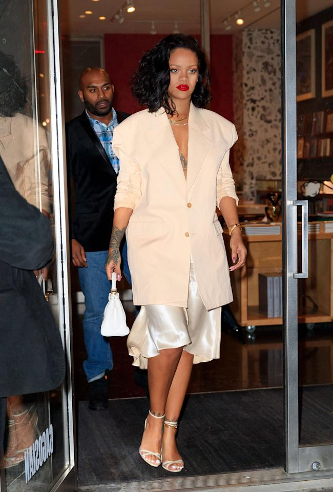 "<p>This outfit was anything but boring. In 2019, <a class=""sugar-inline-link ga-track"" title=""Latest photos and news for Rihanna"" href=""https://www.popsugar.com/Rihanna"" target=""_blank"" data-ga-category=""Related"" data-ga-label=""https://www.popsugar.com/Rihanna"" data-ga-action=""&lt;-related-&gt; Links"">Rihanna</a> paired a <a href=""https://www.popsugar.com/fashion/Rihanna-Slip-Dress-Blazer-January-2019-45731980"" class=""ga-track"" data-ga-category=""Related"" data-ga-label=""http://www.popsugar.com/fashion/Rihanna-Slip-Dress-Blazer-January-2019-45731980"" data-ga-action=""In-Line Links"">silk skirt with an oversize blazer and went without a shirt</a>, bringing this all-beige look to the next level. </p>"
